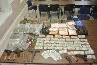 A search of a local residence nets drugs, cash and guns.
