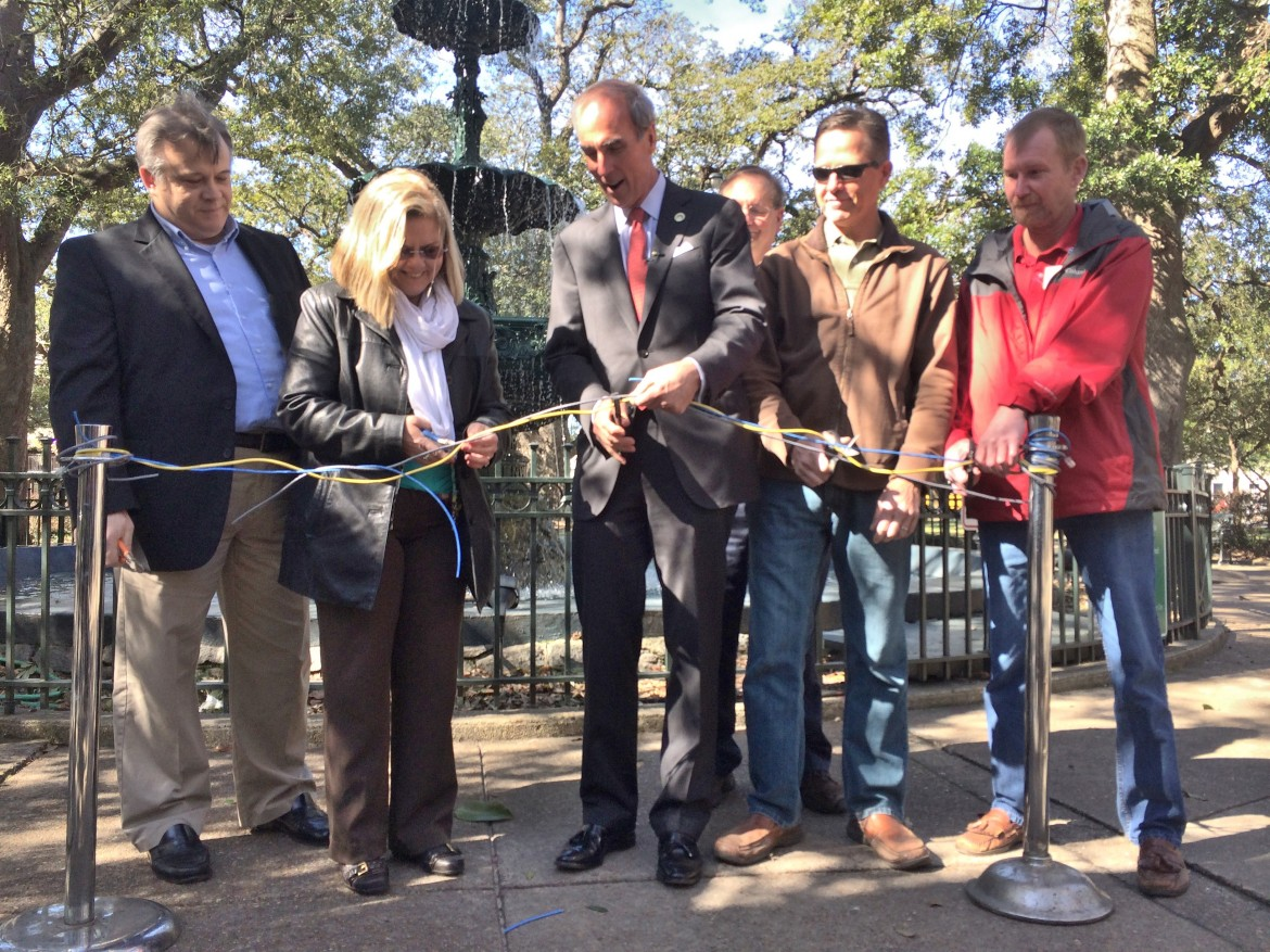 "Mayor Sandy Stimpson and members of the city's IT department cut the ""ribbon"" on free public Wi-Fi at Bienville Square in downtown Mobile Feb. 21."