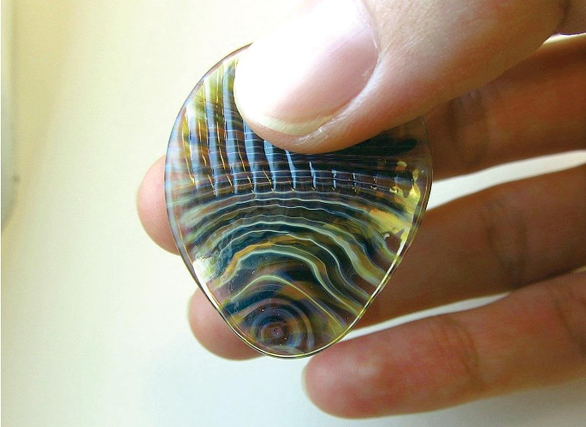Guitar picks made from glass produce rich tones