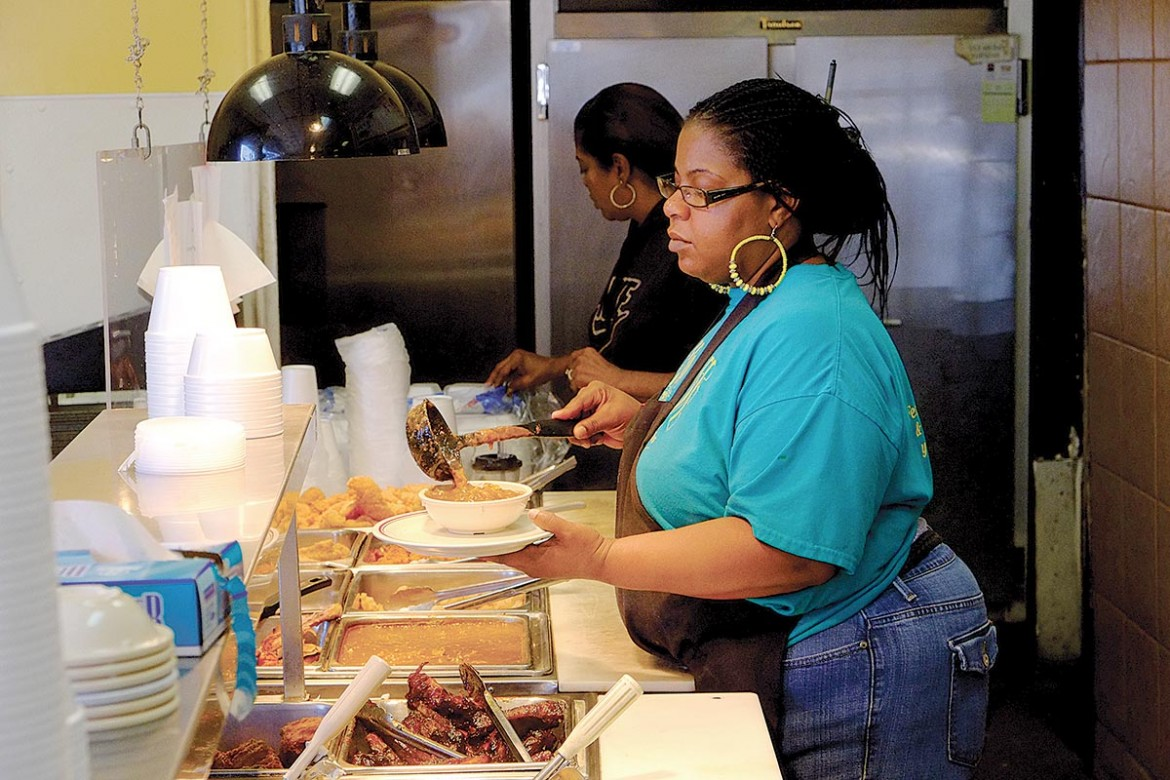 """The Backyard Café on Springhill Avenue proudly claims the title as """"Mobile's soul food connection."""""""