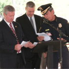 Sheriff Sam Cochran, FBI Special Agent in Charge Robert Laskey and Mobile Police Chief James Barber read names on the Roll of Honor.