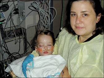 Amelie Trice holding her son for the first time after his transplant in July 2007.