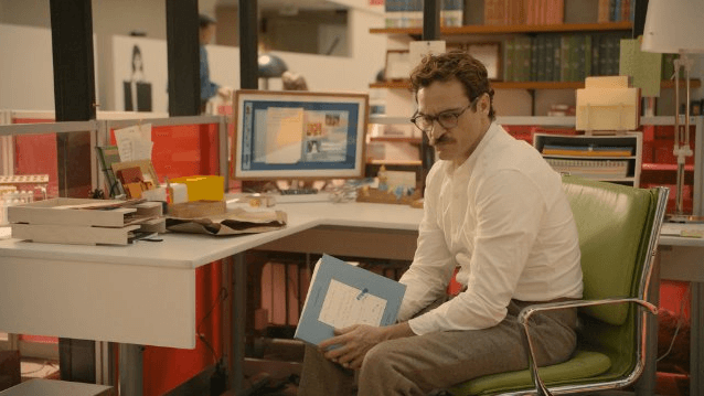 Joaquin Phoenix plays a ghost-writing divorcee who falls in love with a computer operating system in Spike Jonze's 'Her,' now available for streaming or on DVD.