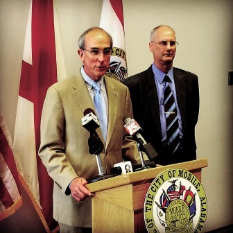 Mayor Sandy Stimpson introduces Public Safety Director Rear Admiral Richard Landolt at a press  conference July 1.
