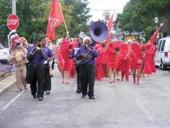 """Indians, """"mistresses"""" and a crew of pirates and skeletons led by the Bay City Brass Band paraded down Dauphin Street for the inaugural Joe Cain Footmarchers' Ball."""