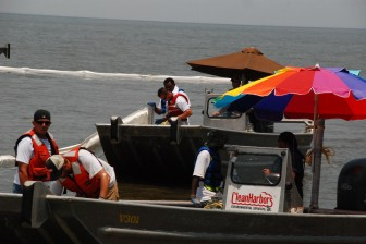 Workers deploy boom in Mobile Bay near Fairhope after the BP oil spill in 2010.
