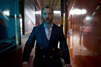 "Jude Law is outshined by co-star Richard E. Grant in ""Dom Hemingway."""