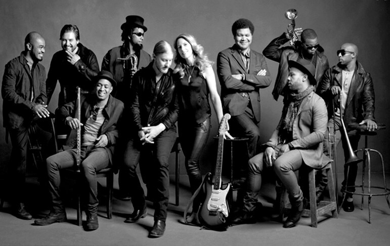 Husband and wife musical team Derek Trucks and Susan Tedeschi (center) lead the Tedeschi Trucks Band.