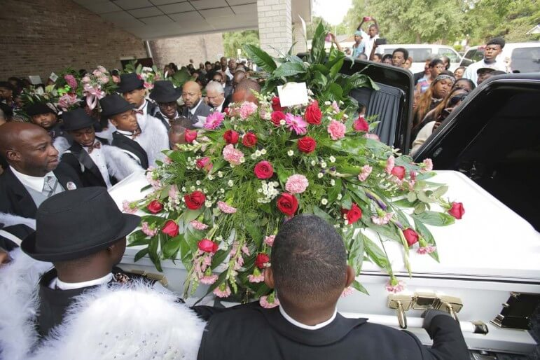 The casket of 8-year-old Hiwayi Robinson is loaded onto a hearse after funeral services Sept. 27 in Prichard, Alabama.
