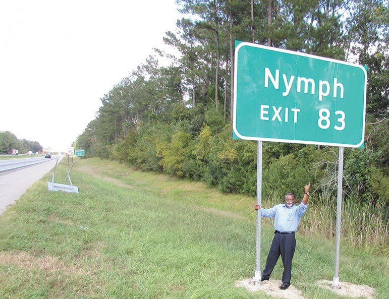 Councilman Fred Richardson proudly stands under a new sign along I-65 for his birthplace of Nymph, a very small community in Conecuh County. Richardson personally requested the sign from the Alabama Department of Transportation and it cost taxpayers $3000, raising the question of whether it was a good use of public money?