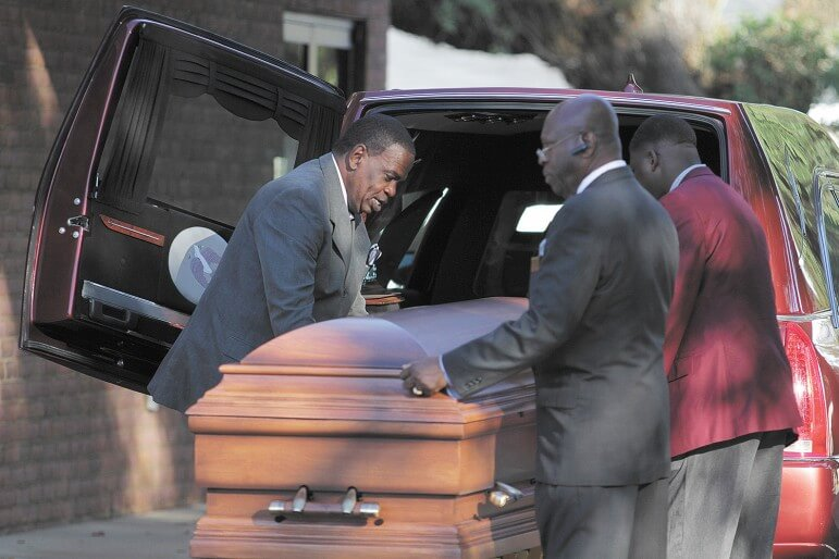 Pallbearers prepare to escort Noble Beasley to his final resting place last week.