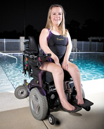 "Chrysa Nowell of Daphne competes on the high school swim team. ""I wanted to be part of something,"" she said."