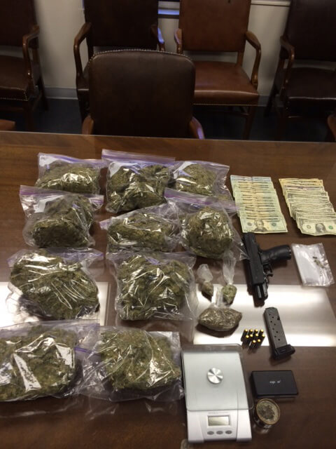Marijuana, spice, paraphernalia and weapons recovered during a recent raid executed by the Mobile County Street Enforcement Narcotics Team.