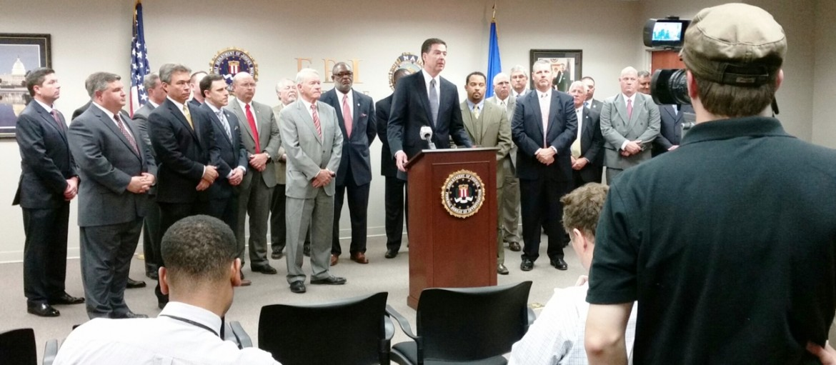 FBI Director James Comey spoke to reporters during a visit with local law enforcement officials and special agents from the Mobile field office Dec. 2.