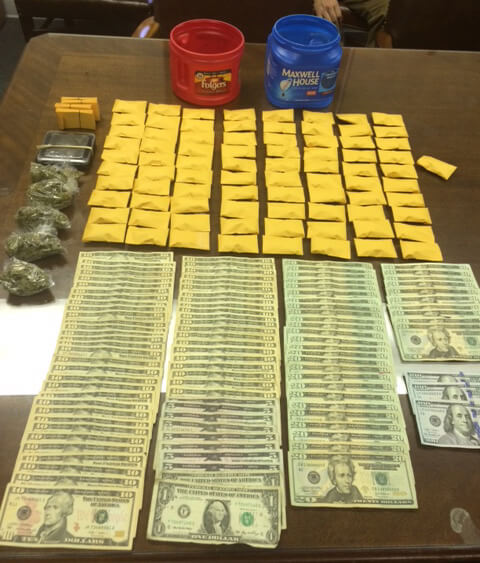 Search warrant yields two arrests, pound of marijuana