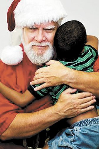 A photo captures the moment Santa Ernest broke through to a boy traumatized after Hurricane Katrina.