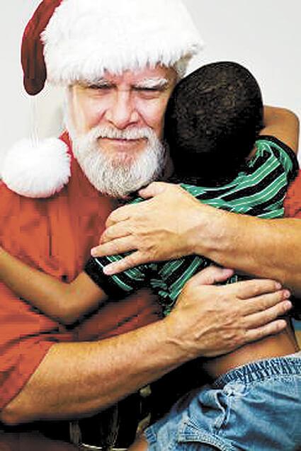 COVER STORY: The more the merrier: Santas share their Christmas spirit
