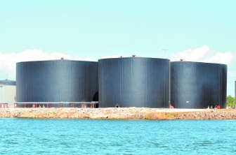 Petroleumn storage tanks on property owned by Arc Terminals are shown on the Mobile River near downtown Mobile.