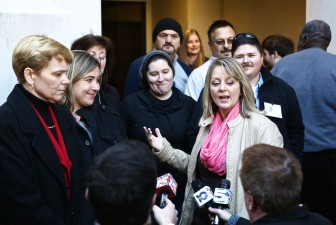 Kim McKeand, Cari Searcy and their lawyers address media on Monday, Jan. 26.
