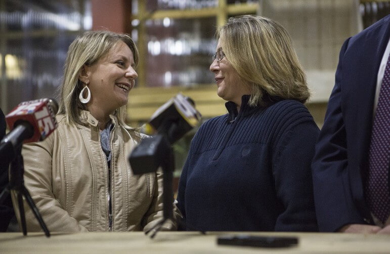 Kimberly McKeand and Cari Searcy celebrate a court victory Jan. 23 at Lap's Grocery and Grill on the Causeway, after a federal judge overturned Alabama's ban on same-sex marriage. The couple's next plan is to finalize Searcy's adoption of McKeand's young son.