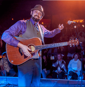 """Mobile singer-songwriter Eric Erdman debuted his new album """"No Slowing Down"""" at Soul Kitchen Jan. 13 with a stage full of friends lending support."""
