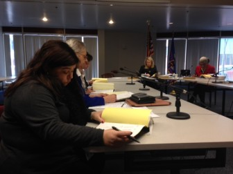 Staff members from the Finance Department brief Mobile County Commissions on 2014 financial numbers during a conference, Feb. 5.