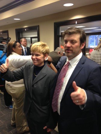 Attorneys David Kennedy and Christine Hernandez celebrate after a victory in court of the state of Alabama and the Probate Court of Mobile in 2015.