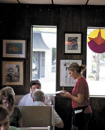 "Hillary Hamlin takes customers' orders at the Dew Drop Inn last Saturday. Her uncle, owner Kenneth Hamlin, said he does not enforce a ""tip pool"" at the restaurant."