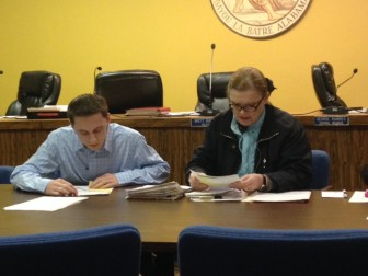 Bayou la Batre Councilors Austin Collier and Annette Johnson go through the city's bills individually.