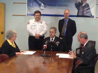 MCPSS Superintendent Martha Peek, left; Assistant Fire Chief Billy Pappas, MCPSS Army Instruction Junior Reserve Officer Training Corps Program Director Col. Robert F. Barrow, Public Safety Director Rich Landolt and Mobile Mayor Sandy Stimpson are pictured at a news conference.