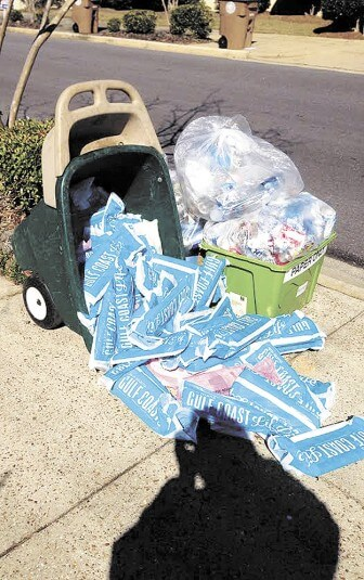 Over 180 ad circulars collected off neighborhood curbs during a two-week period by a resident.