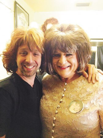 A fan, left, tries on Miss Loretta's wig recently.