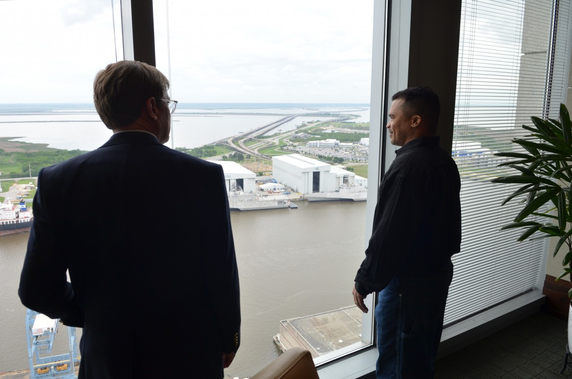 Former Alabama death row inmate William Ziegler absorbs the view from the 30th floor of the RSA Tower in downtown Mobile minutes after being released from jail April 16, along with attorney Henry Callaway.