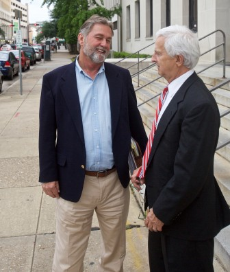 John Melvin Hastie Jr. speaks with attorney Jeff Deen April 29 outside a trial he is facing for tax evasion, along with his wife Mobile County License Commissioner Kim Hastie.