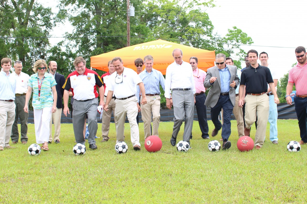Mayor Sandy Stimpson, Councilman John Williams and other officials kickoff the groundbreaking of new Herndon Park soccer fields.