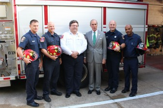 Mobile Fire-Rescue Department Capts. Steven McEvoy, from left, Jon Wilson, MFRD Chief Billy Pappas, Mayor Sandy Stimpson, Capts. Chad Sprinkle and Michael Chestang Jr. pose for a following the announcement of MFRD promotions on Friday.