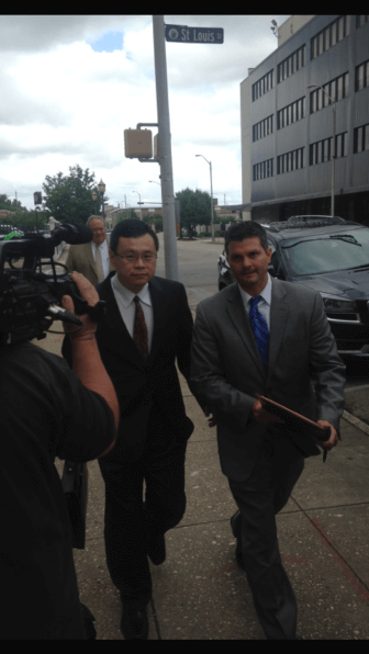 Dr. Xiulu Ruan arrives for an arraignment in federal court on May 28.