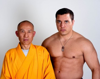 Pat Barry of New Orleans, right, a UFC fighter and World Sanshou silver medalist, started his professional fighting career in Mobile. He is shown with Grand Master Shi DeRu.