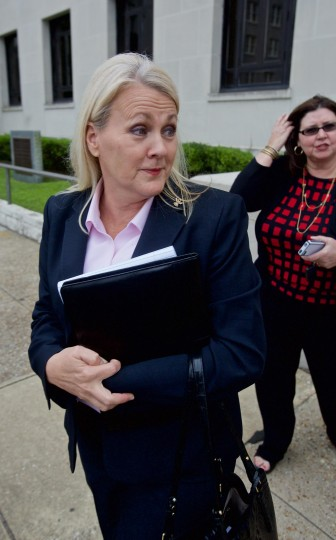 Mobile County License Commissioner Kim Hastie leaves a court hearing earlier this year.