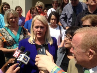 Mobile County License Commissioner Kim Hastie cries after being acquitted of 16 federal charges.