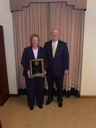 Fairhope City Clerk Lisa Hanks was named the Alabama Municipal Clerk of the Year by the Alabama Association of Municipal Clerks and Administrators. She is pictured with Fairhope Mayor Tim Kant.