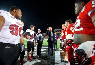 Mayor Sandy Stimpson tosses the coin at the 2014 GoDaddy Bowl featuring Arkansas State and Ball State. This year's game will be played December 23, rather than its traditional date in January.