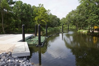 Mobile's new $660,000 Bandalong litter trap spans just half of Eslava Creek, but city officials claim it will be effective.