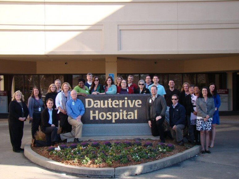 CPSI staff pose with a client hospital.
