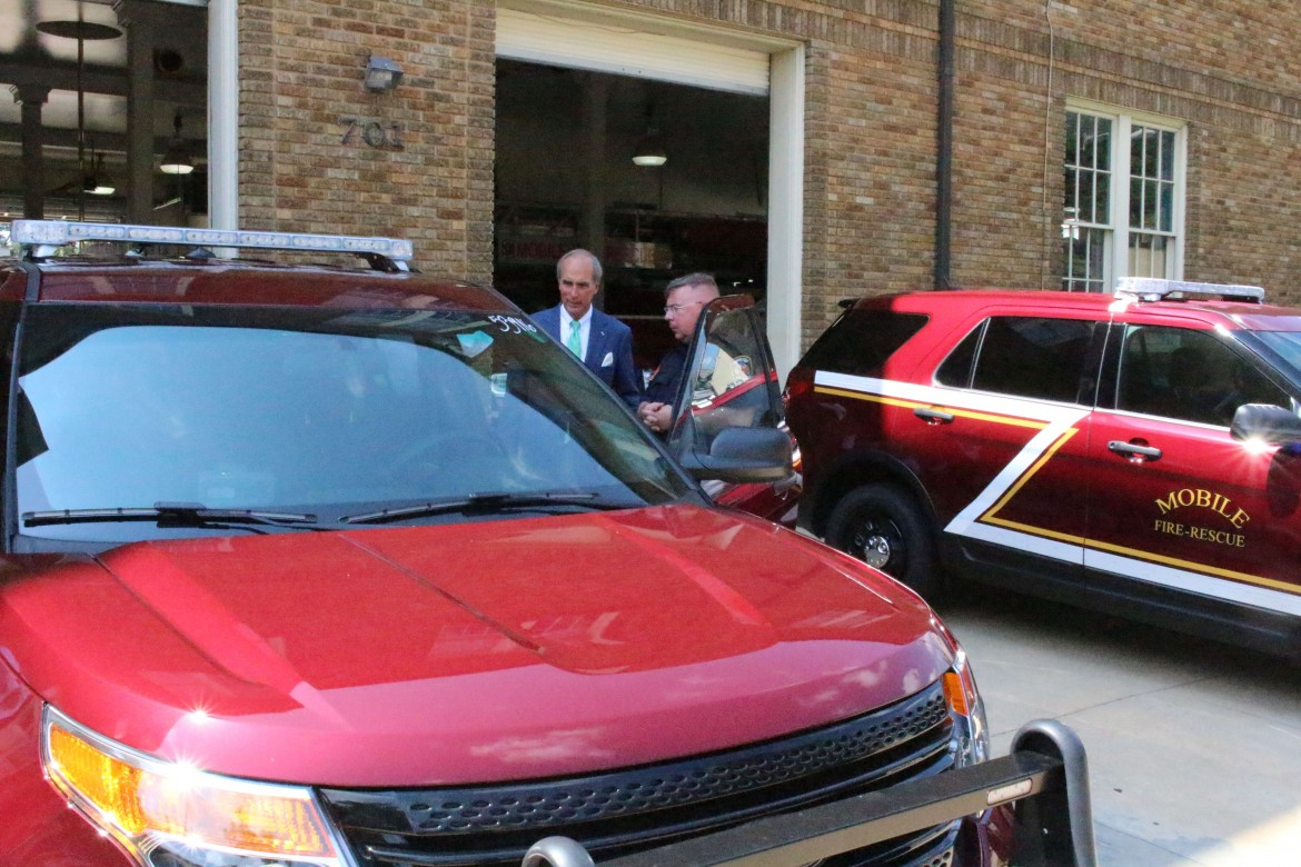 MFRD Capt. Jack Busby, district chief of logistics shows Mayor Sandy Stimpson the interior of one of the department's new sport utility vehicles.