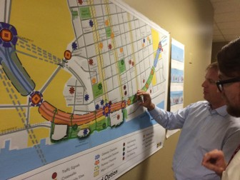 City of Mobile Communications Director George Talbot reviews a draft proposal for redeveloping Water Street with a reporter last month.
