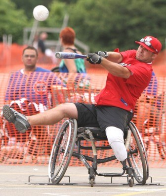 "Wheelchair softball is slow-pitch, played for seven innings, and players must pass through chalk-outlined ""bases"" to score points."
