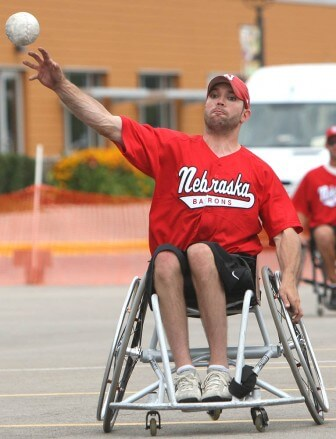"""Wheelchair softball is slow-pitch, played for seven innings, and players must pass through chalk-outlined """"bases"""" to score points."""