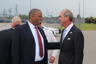 Anthony Foxx talks with Mayor Sandy Stimpson, during a visit to Mobile Thursday.