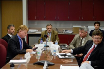 Several county officials and legal advisors held a invitation-only press conference on July 31 related to the Mobile County Communications District.  (Gabe Tynes)